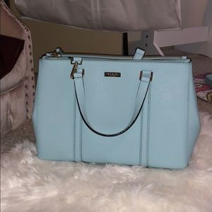 Baby blue Kate Spade purse with shoulder strap